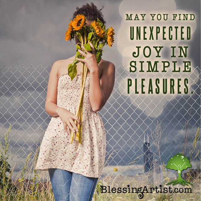 Woman holding a bunch of sunflowers with message May You Find Unexpected Joy in Simple Pleasures